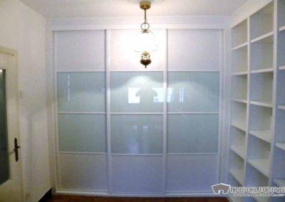 armarios blancos con libreria puertas correderas decuore